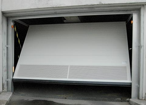 Porte garage basculante joint isolation id es for Porte garage basculante castorama