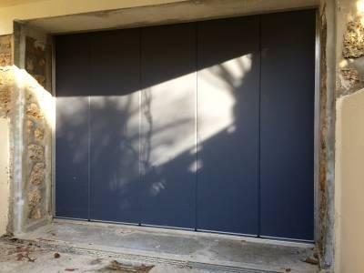 Porte de garage sectionnelle laterale motoris e normstahl - Prix porte de garage laterale motorisee ...