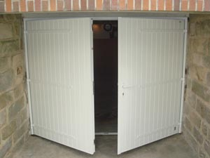 Porte de garage coulissante en fer isolation id es - Isolation porte de garage coulissante ...