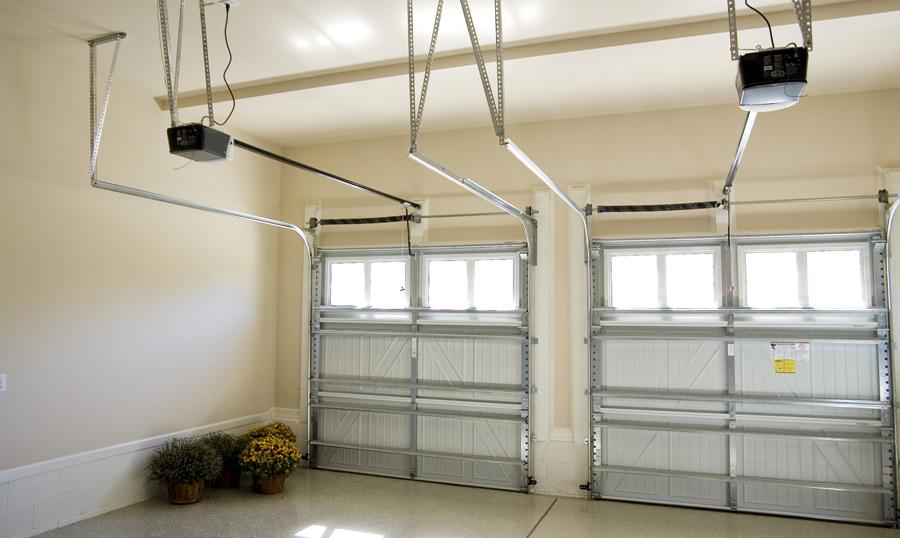 Poser une porte de garage sectionnelle motoris e - Poser une porte de garage coulissante ...