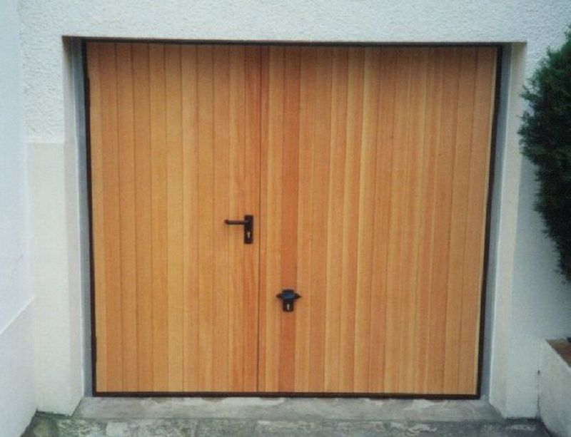 Porte de garage basculante en bois isolation id es for Isolation porte de garage weldom